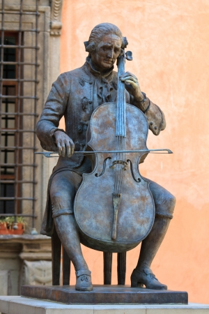 Bronze Statue of a sitting cello player photo