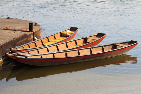 Three river boats / barges bent to pier Stock Photo - 9569805