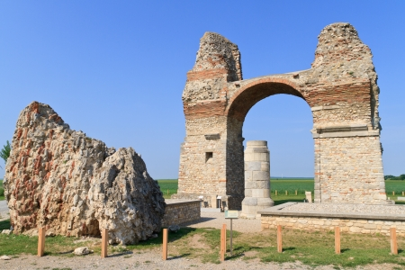 Old Roman City Gate  Heidentor  at Carnuntum Archeological Site, Austria photo