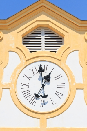 winder: Ancient Clock on old building  with blue sky  Stock Photo