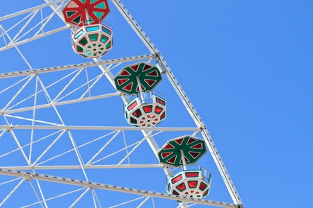 White Ferries Wheel against blue sky photo