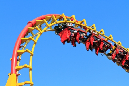 theme park: Rollercoaser Ride  against blue sky  Stock Photo