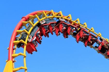 theme parks: Rollercoaser Ride  against blue sky  Stock Photo