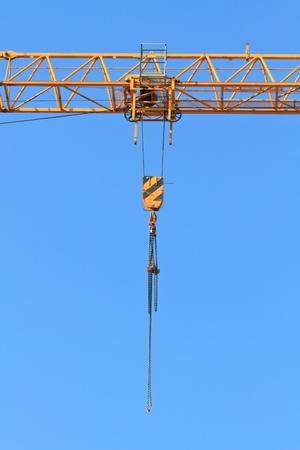 Winch of crane in front of bluie sky photo