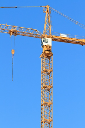 Crane with winch in front of blue sky Stock Photo - 9653353