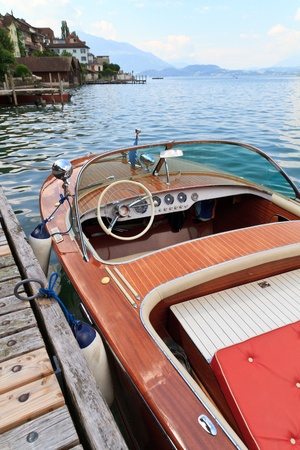 Classical wooden motor boat on alpine lake Stock Photo - 10920079