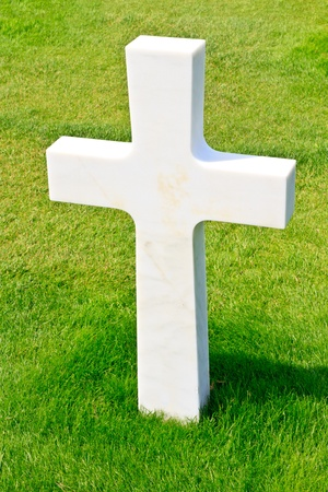 military cemetery: Marble Cross of fallen Soldier, American War Cemetery near Omaha Beach, Normandy (Colleville-sur-Mer) Stock Photo