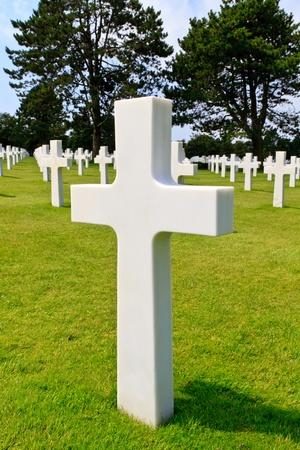 Marble Cross of fallen Soldier, American War Cemetery near Omaha Beach, Normandy (Colleville-sur-Mer) photo