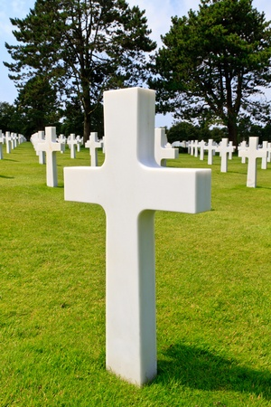 omaha: Marble Cross of fallen Soldier, American War Cemetery near Omaha Beach, Normandy (Colleville-sur-Mer) Stock Photo