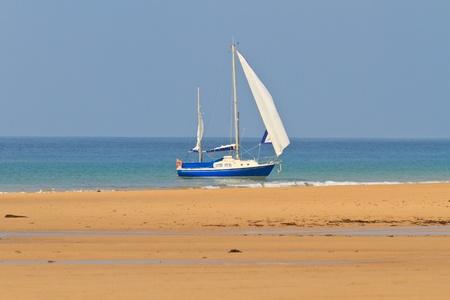 Blue Yacht anchored near sandy beach Stock Photo - 11081750