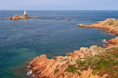 Corbiere Lighthouse and Rocky Coast, Jersey, The Channel Islands photo