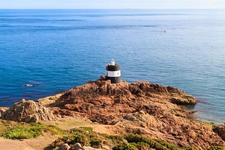 Noirmont Point Lighthouse, St. Aubin`s Bay, Jersey, The Channel Islands photo