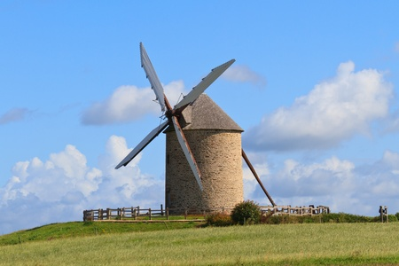 wind mills: Old windmill in France (Near Mont-Saint-Michel) Stock Photo