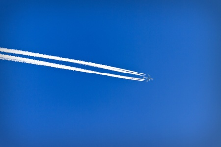 pollution free: Trace of an airplane against blue sky