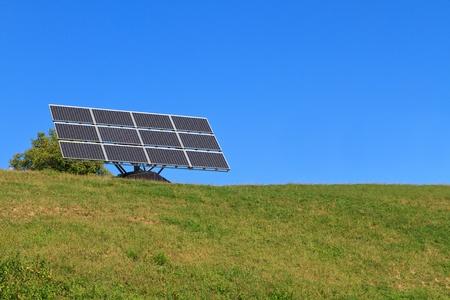 Solar Panel on green meadow (blue sky) photo
