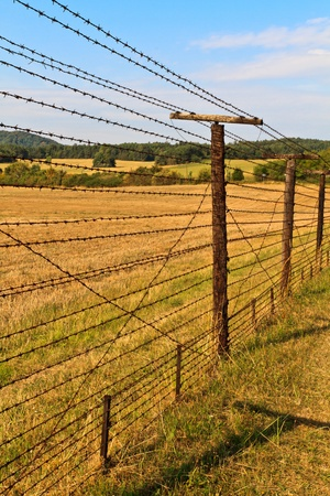bearded wires: Remains of iron curtain near border of Czech republic and Austria. Iron curtain divided Europe in years 1948-1989.