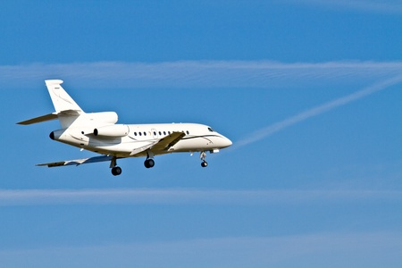 Landing Aircraft  Private Jet (blue sky) photo