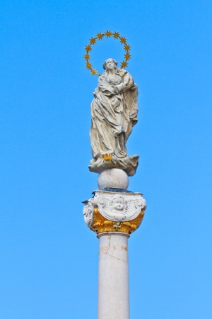 holy mary: Holy Mary Statue on white marble column Stock Photo