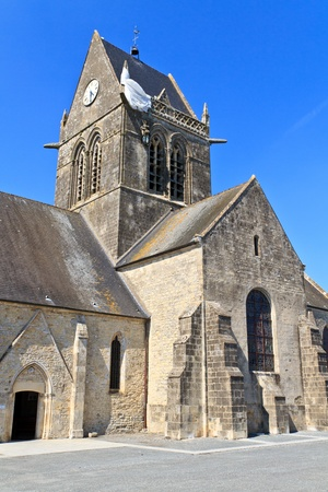 mere: Paratrooper hanging from church, St. Mere Eglise, Normandy, France