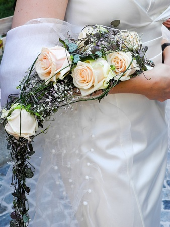 Bride holding her bridal flower bouquet in her hand photo