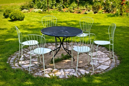 Garden table and chairs  on green lawn  photo