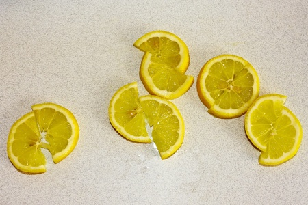 Lemon Slices on white kitchen table Stock Photo - 11392913