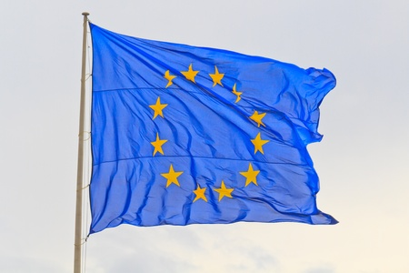 Flag of the European Union with flag pole waving in the wind photo