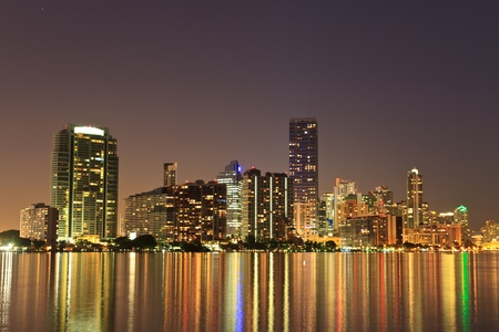 Miami Florida bayfront skyline at night (actual reflections in water) photo