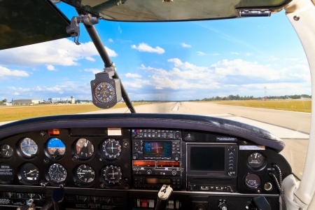 aircraft landing: Cockpit view from small aircraft taking off from runway Stock Photo