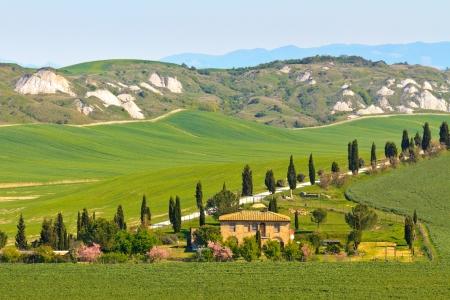 Typical Tuscany landscape view with villa (Crete Senesi region near Siena) photo