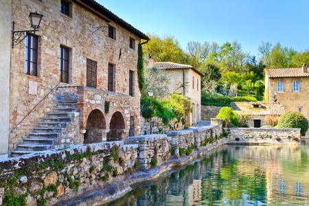 Old thermal baths in the medieval village Bagno Vignoni, Tuscany, Italy Stock Photo - 13690297
