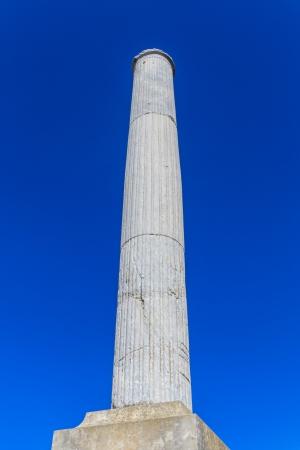 Column on blue sky background (greek / roman) Stock Photo - 16411751