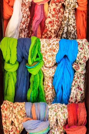 Colorful scarves at the market place photo