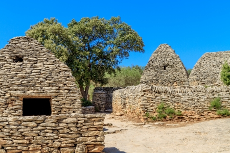 Stone huts in the Bories Village near Gordes, Vaucluse, Southern France photo