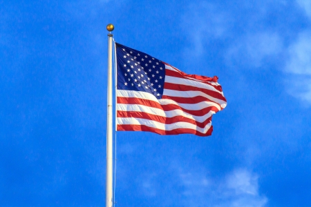 Flag of the United States of America on flag pole photo