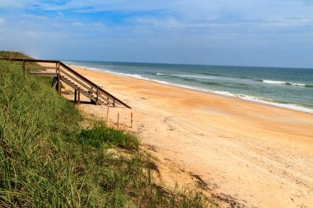 Florida beach with wooden ocean access photo