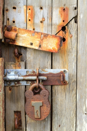 Rusty ancient door lock (close up view) photo