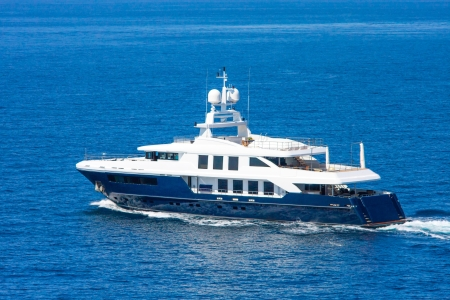 A large private motor yacht under way out at sea photo