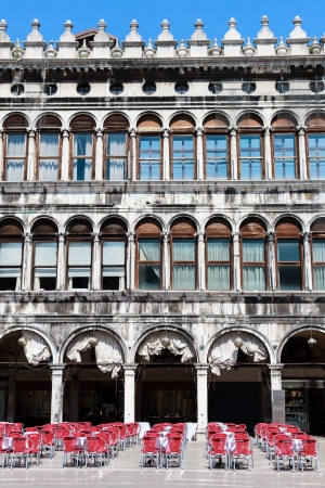 Venice, Piazza San Marco - Facade and arcades of old palazzo photo