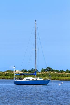 anchoring: Sailing boat anchoring near beach coastline