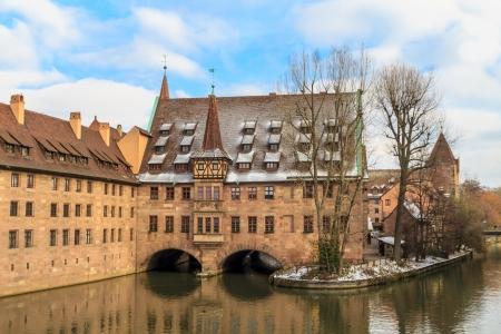christkindlesmarkt: Nuremberg at Christmas time, ancient medieval hospital along the river,  Germany