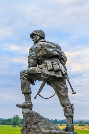 a memorial to fallen soldiers: Iron Mike Statue commemorating US airborne soldiers during Normandy Invasion, France