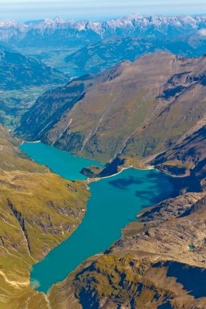 basin mountain: Kaprun reservoir lake and surrounding Grossglockner mountain range aerial view, Salzburg, Austria Stock Photo
