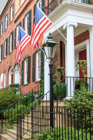 Colonial Red Brick Architecture with American Flags photo