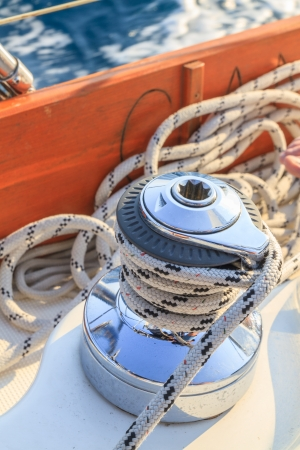 yachting: Sailboat winch and rope detail on yacht