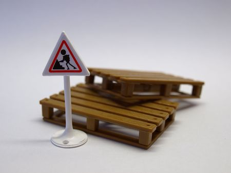 Plastic road sign and cargo pallets on white background Stock Photo - 6486869
