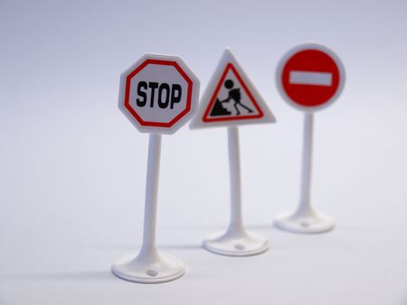 Plastic road signs on white background photo