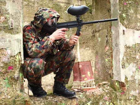 Military paintball player in  action  photo