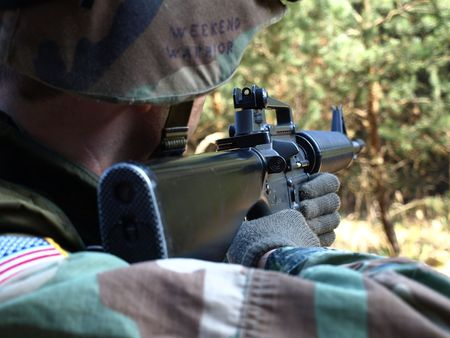 marksman: Airsoft player as American soldier take aim Stock Photo