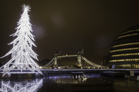 Tower bridge in London on a December morning with a Christmas Tree Stock Photo
